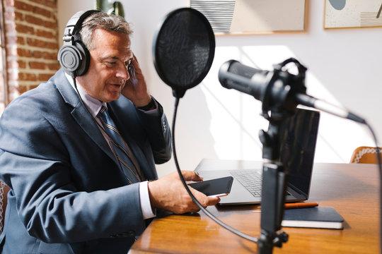 Businessman recording a podcast