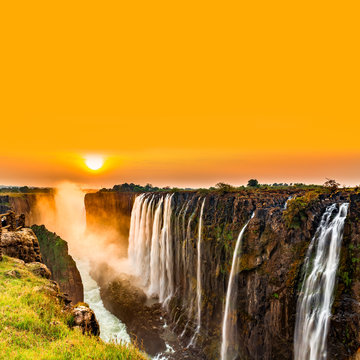 Sunset over Victoria Falls with orange sky