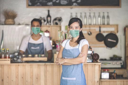 portrait of waitress at the shop wear face masks