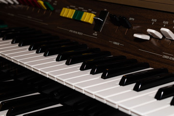 piano or electric organ with two keyboard.