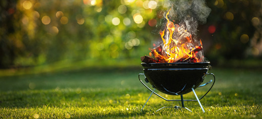Poster Jardin Barbecue Grill with Fire on Open Air. Fire flame