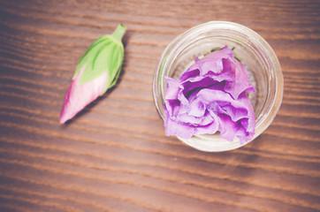 Fototapeta High Angle View Of Purple Flower In Vase On Wooden Table