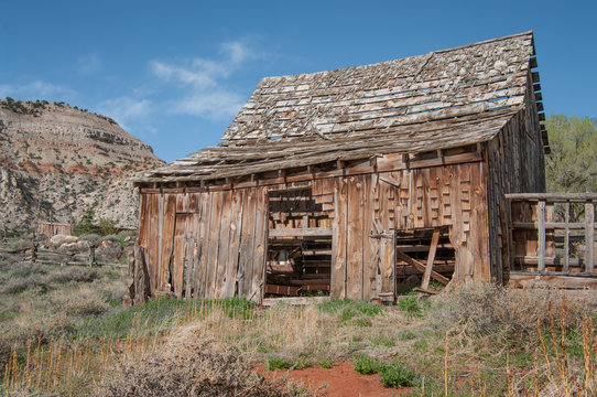 Old Wooden Barn:  A barn with missing shingles and side boards weathers in the sunshine of southern Utah.