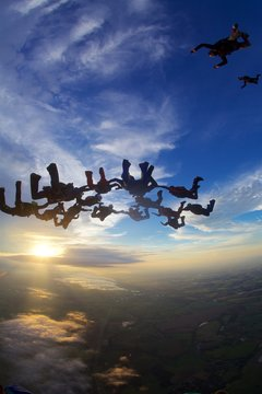 skydiving big group of people at sunset