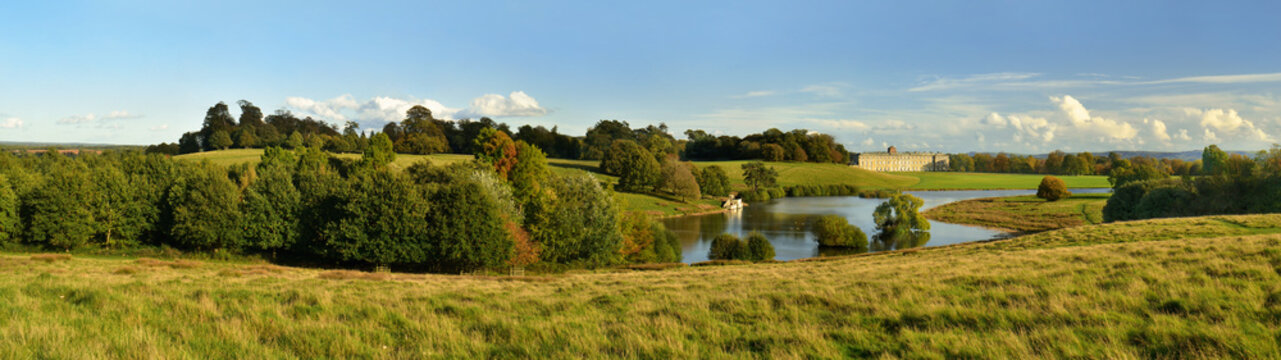 Petworth Park House in Landscape created by Capability Brown at the end of the day, sunset, England, Great Britain. Panorama