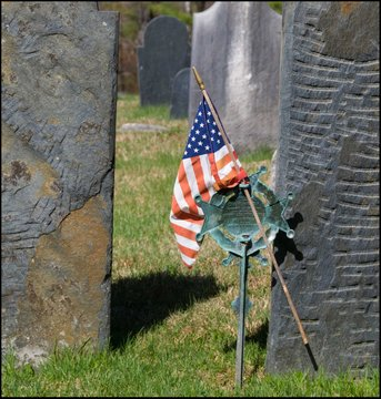 Woman With Umbrella Flag In Cemetery