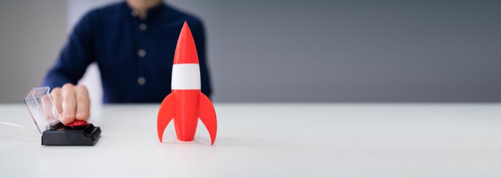 Businessman's Hand Launching Rocket