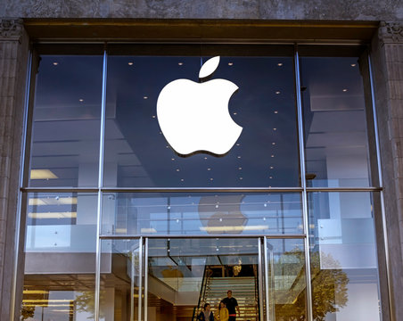 Hamburg, Germany: Logo of Apple Inc. on a Apple store. Apple is the multinational technology company headquartered in Cupertino, California and sells consumer electronics products.