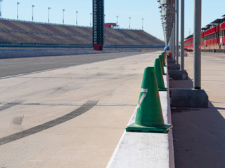 Green Safety Cones on Pit Area At Race Track