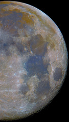 Big closeup to the full phase Moon, right part isolated in the black space, with its colors.