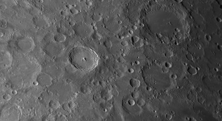 Close up to the Tycho crater on the Moon with also details into background.