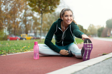 Sporty woman streching her legs