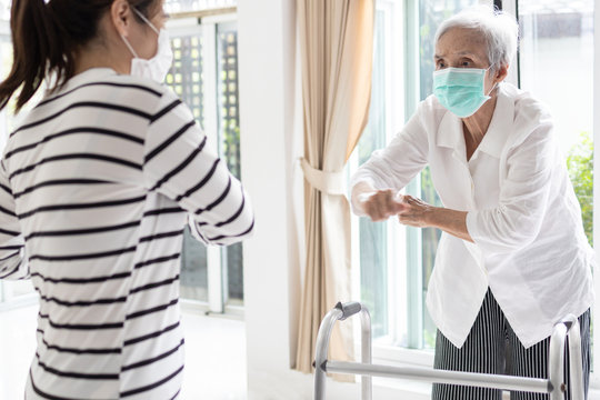 Female caregiver is doing exercise activities for the elderly,senior woman working out at home to reduce stressful,stay home during the outbreak of Covid-19,fitness workout for health care from home