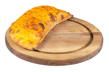 tasty homemade calzone pizza on a white plate. italian food isolated on the white background