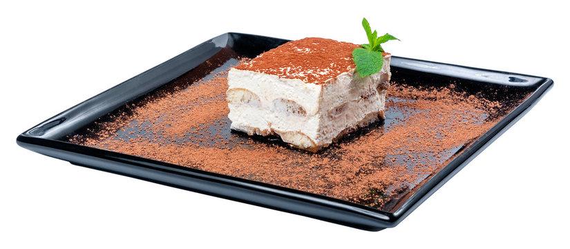 tiramisu cake on a black plate