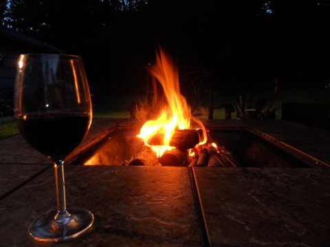 Wineglass By Burning Fire Pit At Night