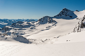 Wall Mural - Panoramic view across snow covered valley in alpine mountain range