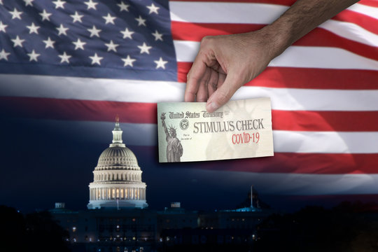Man with Stimulus check and the Capitol and US flag on the Background. The US government is preparing to send out direct payments to help individuals amid the coronavirus pandemic