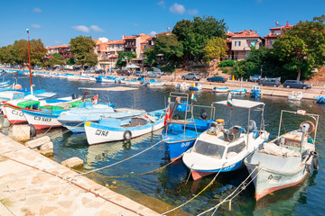 sozopol, bulgaria - SEP 09, 2019: fishing boats in port on a sunny day. embankment on the background of a scenery