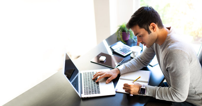 Work from home and social distancing concept. Middle aged businessman working telemarketing online at home