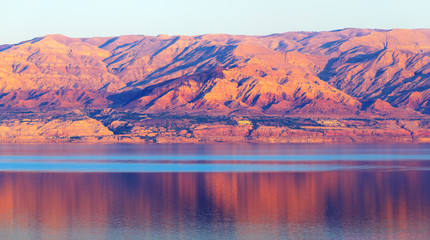 Foto auf Gartenposter Hochrote Dead Sea and mountains at sunset time