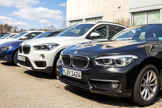 Nurnberg, Germany - BMW cars parked in front of car dealer. view of parked luxury cars in row.