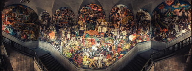 A panoramic view of the stairway mural by Diego Rivera inside the National Palace in Mexico City