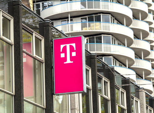 ROTTERDAM, NETHERLANDS : T-Mobile logo on a store. T-Mobile is the brand name used by the mobile communications subsidiaries of the German telecommunications company Deutsche Telekom