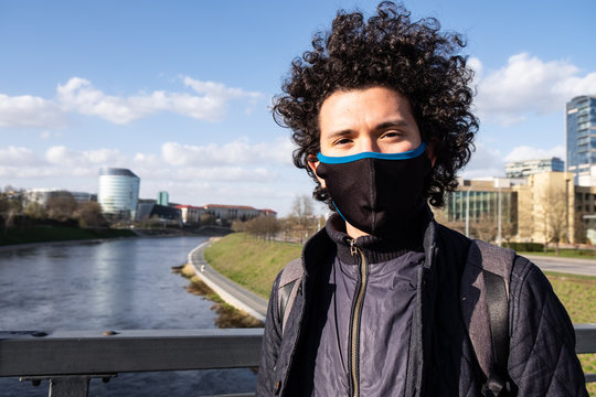 Latin American Man Wearing a Mask in a City