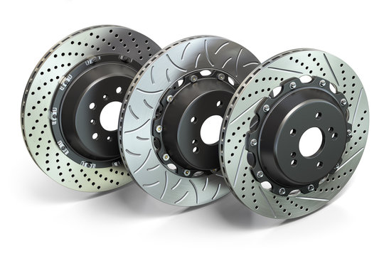 Drilled and slotted brake disks in a row. Different types of brake disks.