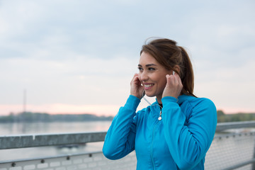 A picture of a fitness woman smiling and getting ready for working out