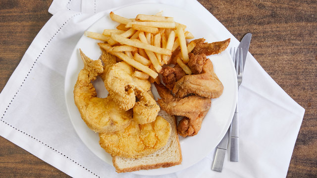 A classic southern style plate of chicken, fish and fries