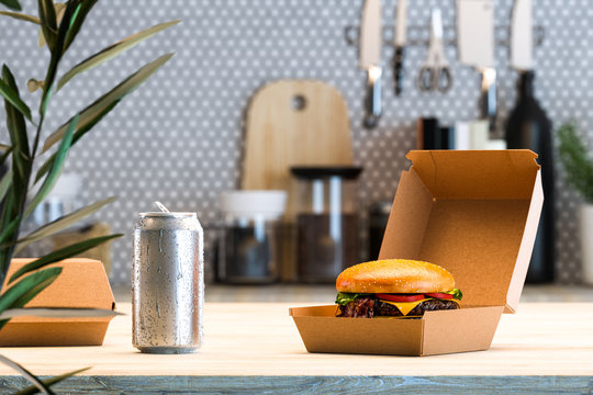 Cheeseburger in Box From Recyclable Craft Paper Or Cardboard Near Aluminium Can With Cold Droplets. Delivery. 3d rendering