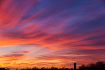 Fototapeten Hochrote Dramatic Sky Over Silhouette Landscape