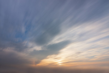 Sky, sun and clouds with ray light during sunset time. Long exposure nature background .. Wall mural