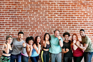 Happy people at the gym Wall mural