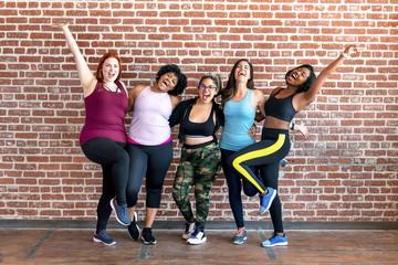 Diverse womens fitness class Wall mural