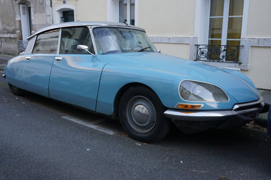 blue vintage DS citroen parked in the street