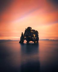 Zelfklevend Fotobehang Diepbruine Sunset at the Hvitserkur basalt stack in northern Iceland