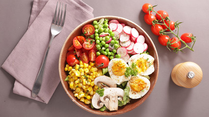 Wall Mural - vegetable salad bowl with tomato, egg, corn, radish and pea- buddha bowl
