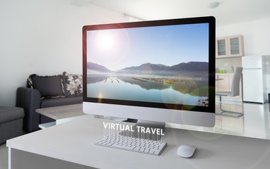 Computer with a view of the bay in the mountains on the screen. Virtual travel Wall mural
