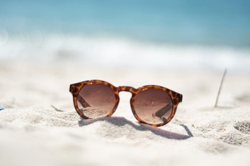 Vintage glasses on the sand of a paradise beach