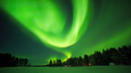 Aurora borealis. Northern lights night photo arctic circle