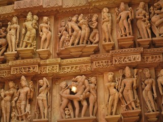 Erotic sculptures and sex poses of man in kajuraho temples, Madhya Pradesh, India. Built around 1050, it is a UNESCO world heritage site, a tourist destination. The concept of textures and postcards. Fotomurales