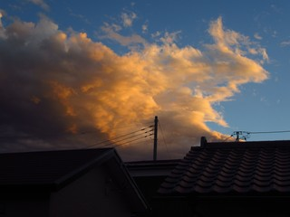 Fototapeta Low Angle View Of Houses Against Sky During Sunset