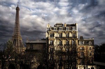 Wall Mural - Eiffel Tower and typical Paris Building after the Storm and under a beautiful Light