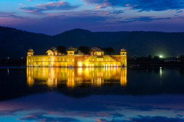 Wall Mural - Rajasthan famous tourist landmark - Jal Mahal Water Palace on Man Sagar Lake in the evening in twilight. Jaipur, Rajasthan, India