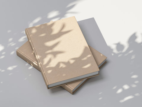 Two beige books Mockup with textured kraft hardcover on white table outdoor