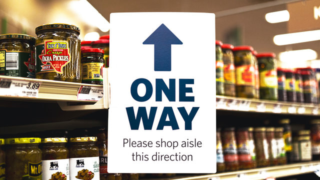 One Way Sign In A Supermarket