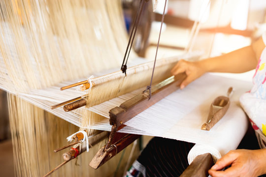 oriental traditional cloth making wooden equipment tools and technique creating pattern elegant cloth, using cotton and silk string stretch and woven by using mechanic wooden machine to weave